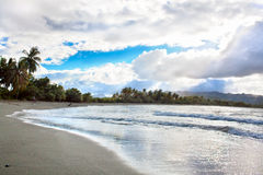 Fantastic contrast on tropical beach. Fantastic contrast on tropical caribbean beach in Baracoa, Guantanamo province, Cuba Royalty Free Stock Photography