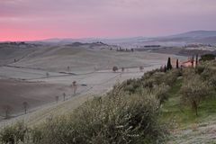 Fantastic dawn over tuscan hills in winter with morning rime , T Royalty Free Stock Image