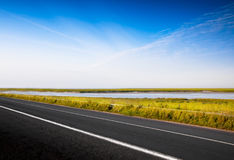 Fantastic desert road with blue sky. A fantastic desert road with blue sky Stock Photos