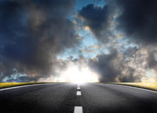Fantastic desert road with clouds. A fantastic desert road with clouds Royalty Free Stock Photos