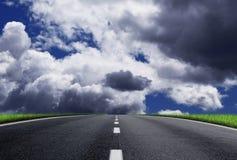 Fantastic desert road with clouds. A fantastic desert road with clouds Stock Photo