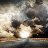 Fantastic desert road with clouds. A fantastic desert road with clouds Royalty Free Stock Photography