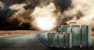 Fantastic desert road with clouds and suitcases. A fantastic desert road with clouds and suitcases Stock Photo