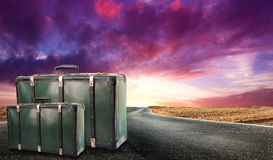 Fantastic desert road with clouds and suitcases. A fantastic desert road with clouds and suitcases Royalty Free Stock Images