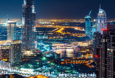 Fantastic elevated skyline of Dubai with city illuminations. Royalty Free Stock Photography