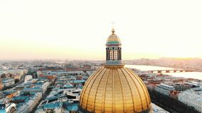 Fantastic flight on drone around the colonnade of St. Isaac`s Cathedral in St. Petersburg at sunset stock video footage