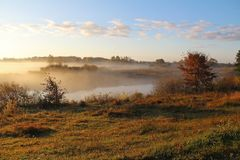 Misty nature landscape on early autumn morning. Russia. royalty free stock photography