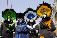 Fantastic four. Four people in costumes in Venice. Green. Blue. White-blue. Yellow Stock Photos
