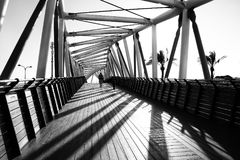 A fantastic game of shadows from the bridge of interesting design. A breathtaking abstract pattern of interesting design expressing beauty and majesty stock images