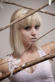 Fantastic girl in branches and feathers Royalty Free Stock Photo