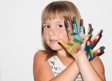 Fantastic girl with painted fingers. Teen girl makes mask by fingers on her face stock photography