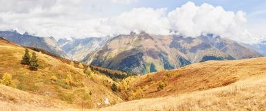 Fantastic golden autumn landscape between the rocky mountains in Georgia. Malvnychi snow-capped peaks Royalty Free Stock Image