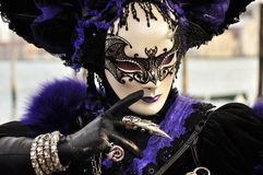 Fantastic gothic mask in venice carnival. Purple and black gothic mask in venice during the carnival in san marco square Stock Images