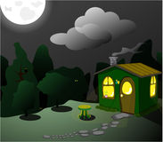 Fantastic green lodge at night Royalty Free Stock Images