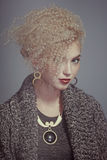 Fantastic hairstyle. Portrait of girl with hairdressing art contest stock photo