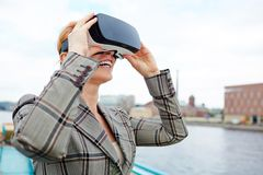 Fantastic. Happy female with vr headset enjoying high quality video of new world Royalty Free Stock Photo