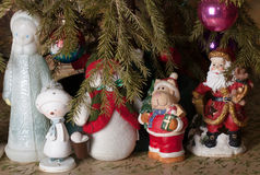 Fantastic heroes: Snow Maiden, Snowman, Santa Claus under the Ch Royalty Free Stock Photography