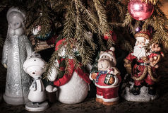 Fantastic heroes: Snow Maiden, Snowman, Santa Claus under the Ch Royalty Free Stock Photos