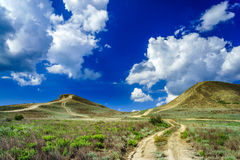 Fantastic hills and blue sky. Stock Photography