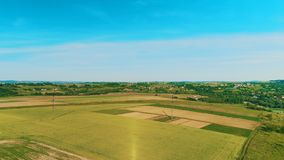 Aerial view, semi panorama view of houses among fields in countryside area. 4K. stock video