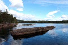 Fantastic huge stone on the Innerdalsvatna lake. Daytime scene in Norway, Europe. Beauty of nature concept background royalty free stock images