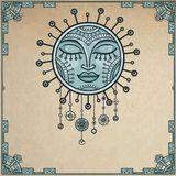 Fantastic image of the sun. Metal amulet. Background - a frame from iron elements, imitation of old paper. Royalty Free Stock Image