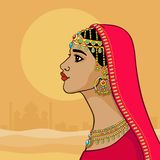 Fantastic Indian princess in a red dress. Profile view. Stock Photos