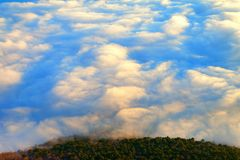 Fantastic island in clouds Stock Image