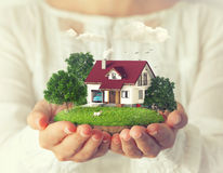 Fantastic island. Small fantastic island with a house and backyard in women's hands stock photos