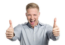 Overjoyed businessman giving thumbs up. Royalty Free Stock Photos