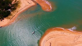 Corumbau, Bahia, Brazil: Aerial view of beautiful river with red sand. royalty free stock image