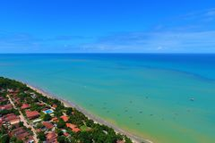 Cumuruxatiba, Bahia, Brazil: Aerial view of a blue sea and clear weather. stock photo