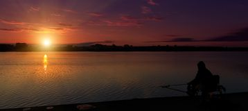 Fantastic landscape, multicolor sky over the lake. majestic sunrise. use as background. color in nature. panorama. Fantastic landscape, multicolor sky over the royalty free stock photos