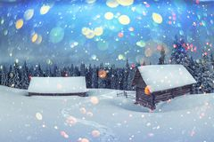 Fantastic landscape with snowy house stock images