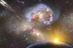 Fantastic landscape of space with a planet on a background of galaxies with a reflection of the rays of the sun. Elements of this. Image furnished by NASA royalty free stock image