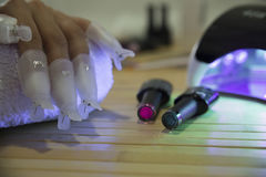 Fantastic manicure in a modern. Beauty shop stock photography