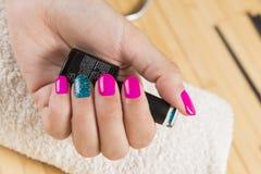 Fantastic manicure in a modern beauty shop. Fantastic manicure in a modern beauty center stock image