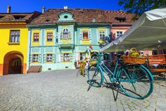 Fantastic medieval street cafe bar with traditional buildings, Sighisoara, Romania stock photography