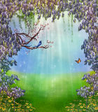 Fantastic morning. View of a fantastic morning with a vine of wisteria an a bird singing on a branch royalty free stock photo