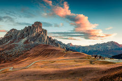 Fantastic morning view from the top of Giau pass with famous Ra Gusela, Nuvolau peaks in background. Colorful autumn sunrise in Dolomite Alps, Cortina d` royalty free stock photos