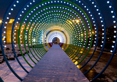 Fantastic multicolored light tunnel. Multicolored decoration in Moscow central park Royalty Free Stock Photography