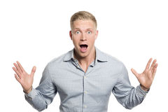 Surprised young businessman with hands up. Stock Image