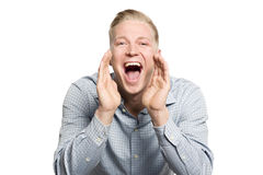 Excited young businessman shouting great news. royalty free stock photos