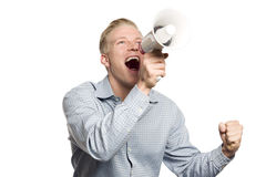 Overjoyed business person shouting with megaphone. Fantastic news: Young happy businessman looking up while shouting with megaphone isolated on white background Royalty Free Stock Photo