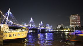 Fantastic night shot of the Golden Jubilee Bridge in London. LONDON, ENGLAND stock footage