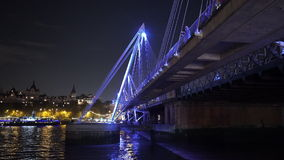 Fantastic night shot of the Golden Jubilee Bridge in London stock footage