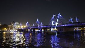 Fantastic night shot of the Golden Jubilee Bridge in London. LONDON, ENGLAND stock video footage
