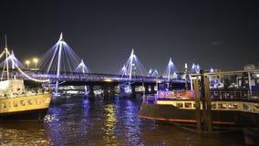 Fantastic night shot of the Golden Jubilee Bridge in London. LONDON, ENGLAND stock video
