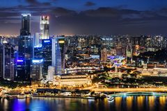 Fantastic night view of downtown in Singapore. Amazing skyscrapers and other modern buildings on dark sky background. Colorful city lights reflected in water stock photos