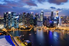 Fantastic night view of skyscrapers at downtown of Singapore. Colorful city lights reflected in water of Marina Bay. Beautiful cityscape. Singapore is a royalty free stock photo